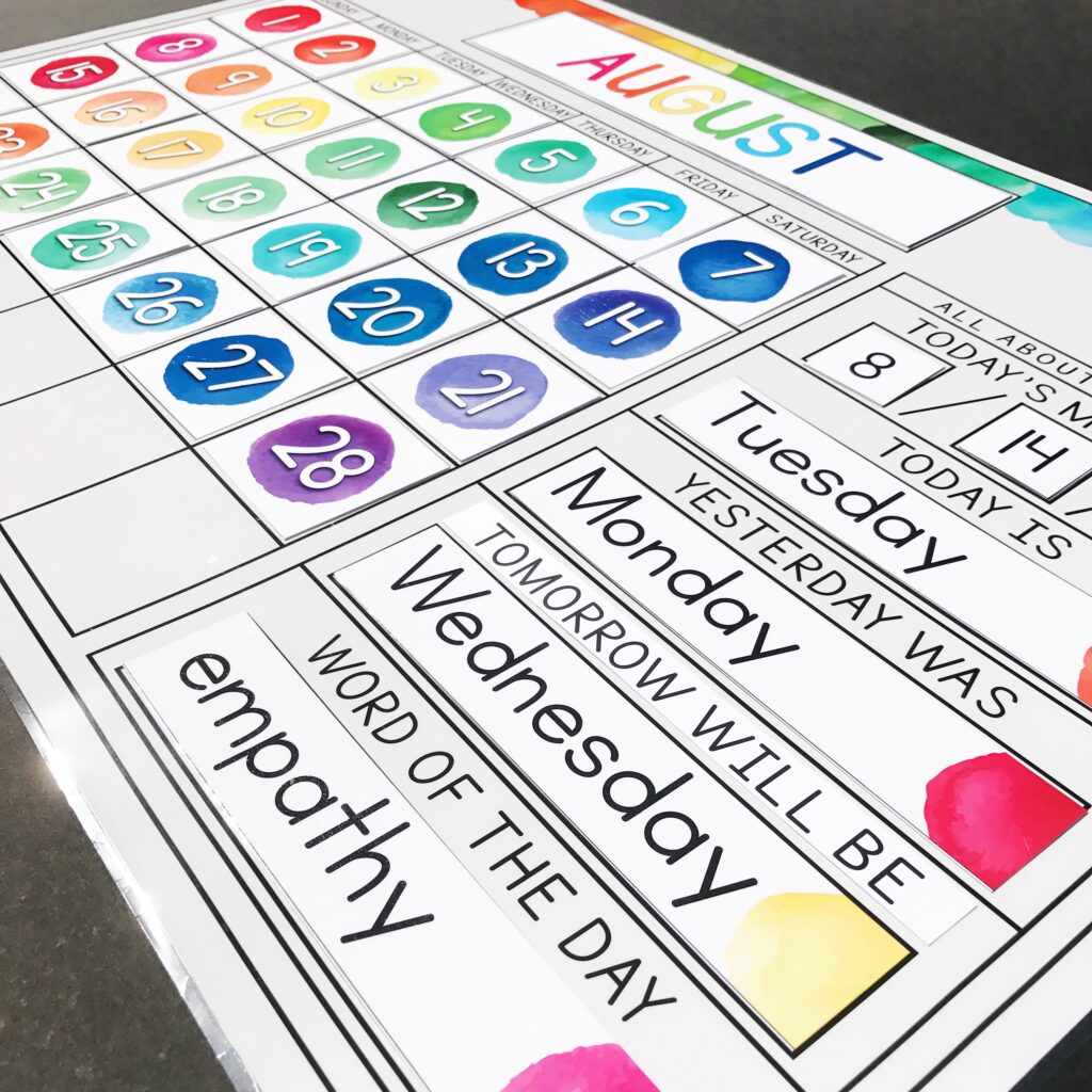 Watercolor calendar kit showing days of the week and word of the day.