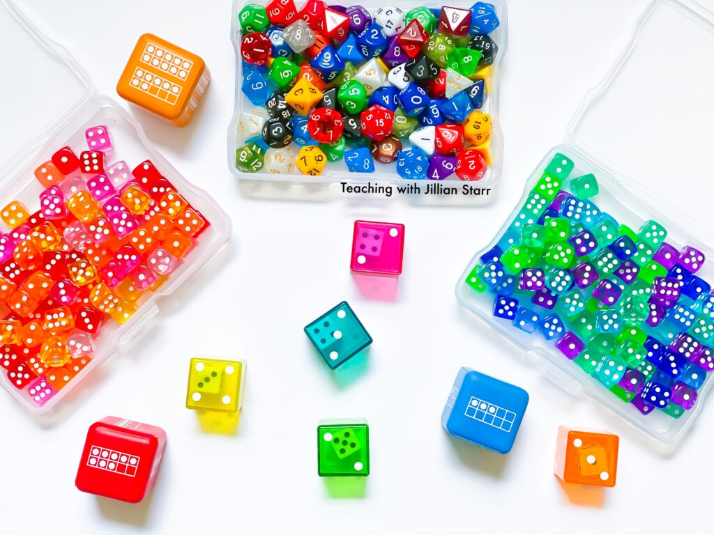 A variety of dice as math manipulatives for first grade.